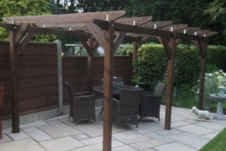 An example of module 5; a double length standalone pergola built on a patio, covering some wicker garden furniture